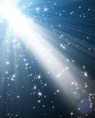 Spotlight with stars — Stock Photo