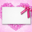 Blank postcard tied with a bow of pink ribbon — Stock Photo #8961536