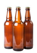 Tres botellas de cerveza negra sobre fondo blanco — Foto de Stock