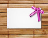 Blank postcard tied with a bow — Stock Photo