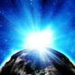 Blue earth in space with rising sun — Stock Photo