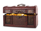 Wooden chest with gold coins — Stock Photo