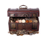 Wooden chest with coins inside isolated — Stock Photo