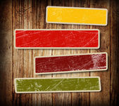 Background with colorful boxes for text on wood background — Stock Photo