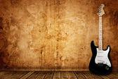 Elektro gitar ve duvar — Stok fotoğraf