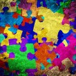Grunge background with colourful puzzles — Stockfoto