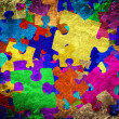 Stock Photo: Grunge background with colourful puzzles