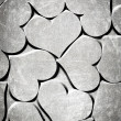 Red hearts on a grunge background — Stock Photo
