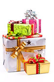 A pile of Christmas gifts in colorful wrapping with ribbons — Foto Stock