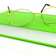 Reading glasses with book — Stock Photo