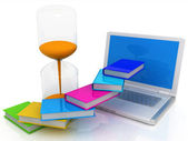 Book an hourglass and a laptop — Foto Stock