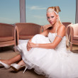 Bride seated on the floor — Stock Photo #9550651