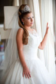 Bride at the window — Stock Photo