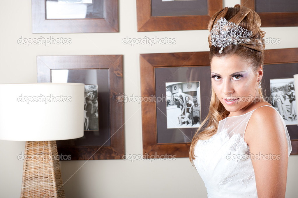 Blond bride with silver tiara and white dress — Stock Photo #9551185