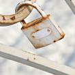 Old padlock on a bridge — Stock Photo