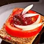 Juicy tomatoes on fresh bread, — Stock Photo