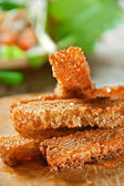 Appetizer with dry bread — Stock Photo
