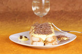 Tiramisù cake served on a white plate — Stock Photo