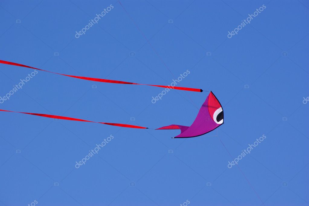 Fish-shaped kite against a vivid blue sky. — Stock Photo #10195998