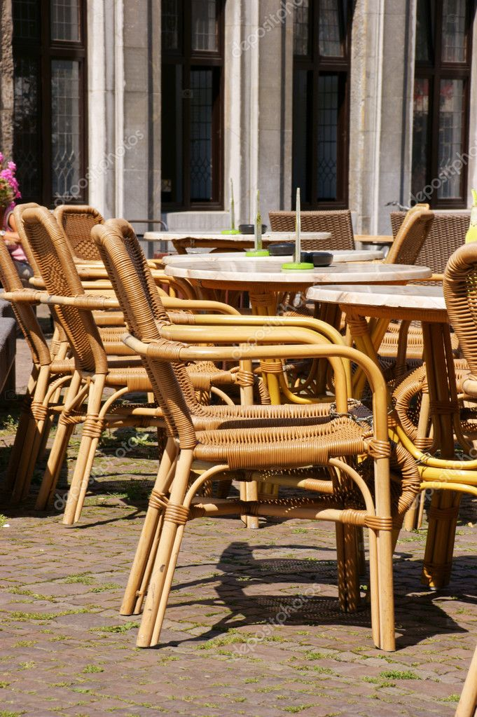 Empty street tables in front of a cafè — Stock Photo #10418731