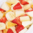 Fresh fruit salad on a white plate — Stock Photo