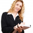 Businesswoman writing on her notepad — Stock Photo