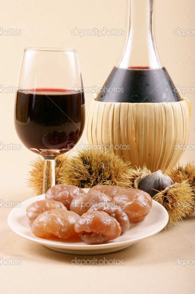 Autumn flavours: chestnuts, marron glacé and young wine. Light brown background. — Zdjęcie stockowe #9021181