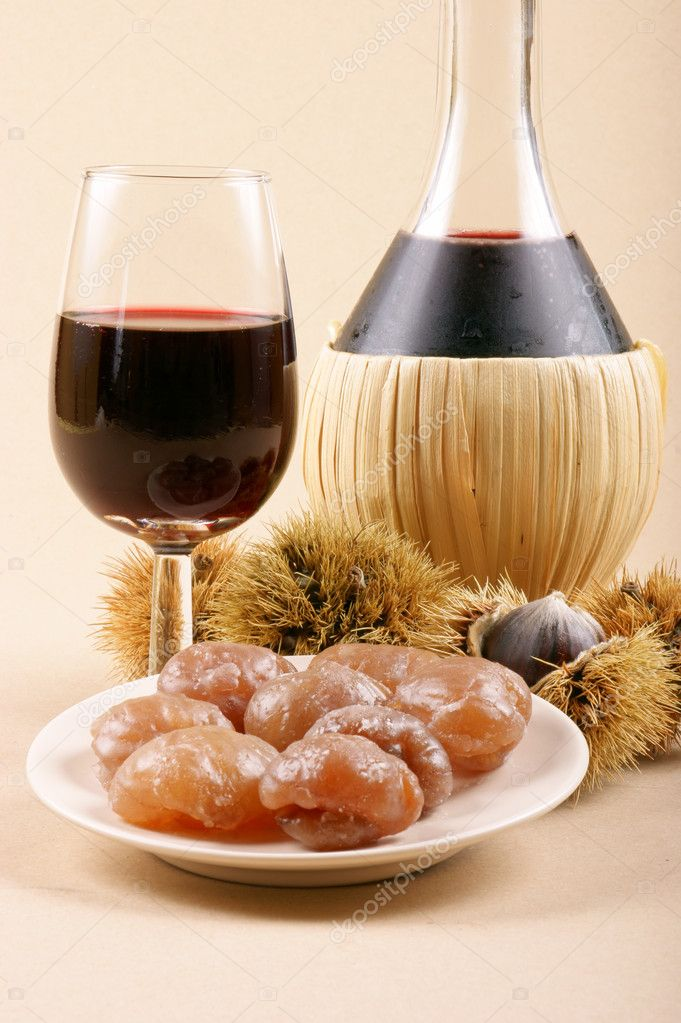 Autumn flavours: chestnuts, marron glacé and young wine. Light brown background. — Stock fotografie #9021181