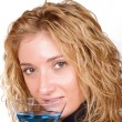 Seductive, young blond woman holding a Martini glass — Stock Photo
