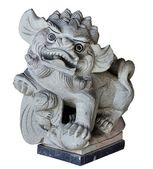 Stone sculpture. The Chinese doggie. — Stock Photo