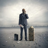 Businessman with gasmask at phone — Stock Photo