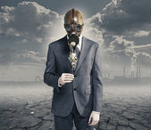 Businessman with dried rose: concept polluted environment — Stock Photo