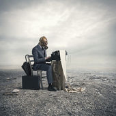 Business wearing a gas mask, write with an old typewriter — Stock Photo