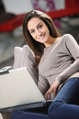 Young Woman on Couch with Laptop — Stock Photo