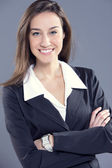 Attractive businesswoman with her arms crossed. — Stock Photo