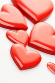 Red hearts on white background — Stock Photo