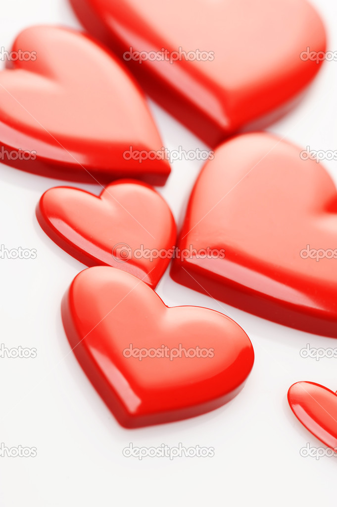 Red hearts on white background — Photo #7983282