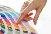 Woman Choosing color from color scale — Stock Photo