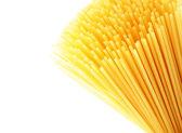Mediterranean diet . Italian pasta, uncooked spaghetti — Stock Photo