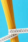 Diet concept, Spaghetti with measuring tape — Stock Photo