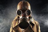 Grunge portrait man in gas mask — Stock Photo