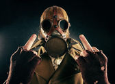 Grunge portrait man in gas mask, fuck sign — Stock Photo