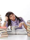 Female student with books on white background — Stockfoto