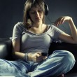Relaxed young woman listening music - Foto Stock