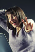 Portrait of woman with a laptop cheering in success, similar pic — Stock Photo