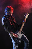 A bassist plays at a live concert — Stock Photo