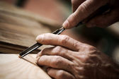 Hands of a craftsman — Stock Photo