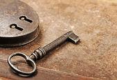 Antique Padlock with key — Stock Photo