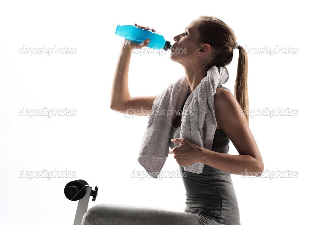 Thirsty young woman drinking after fitness workout. white background — Stock Photo #8503970