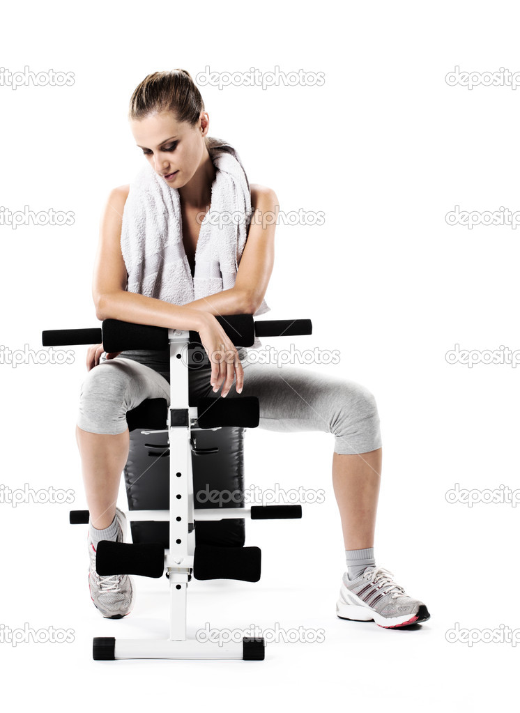 Young woman resting after exercising  Stock Photo #8503973